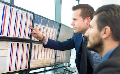 traders analyzing trading screen