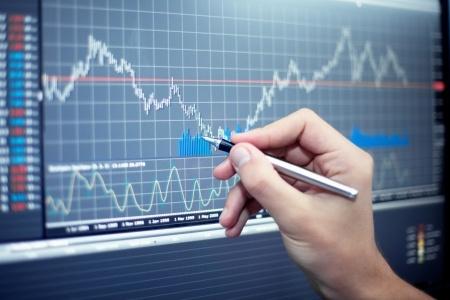 investor analyzing stock market chart